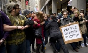 A businessman tries to break through a line of Occupy Wall Street protesters who had blocked access to the New York Stock Exchange